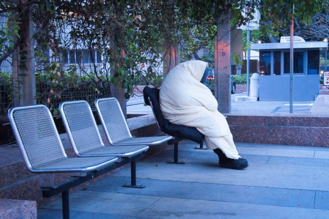 A homeless man in downtown LA in the early morning.