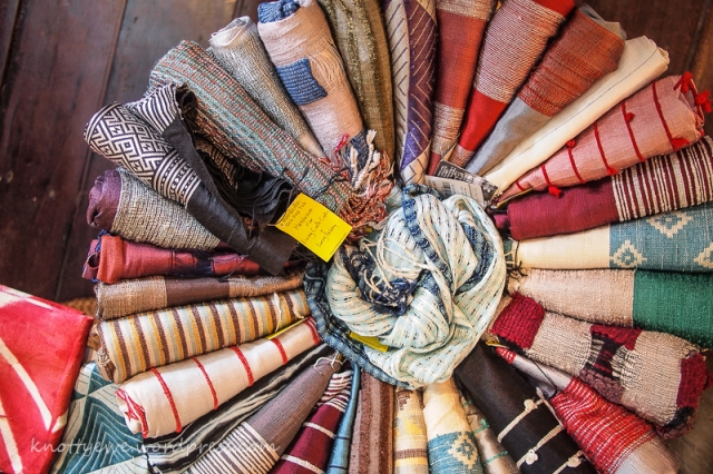 Shopping for handwoven silk scarves in Luang Prabang.